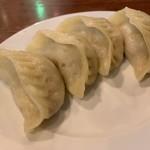 東北人家 - 豚肉・漬け白菜のジャンボ蒸し餃子