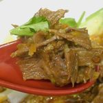 秦唐記 - 具の牛肉は柔らかくオイリーな旨味が口の中に広がるとともにしびれるような辛味も満点!
