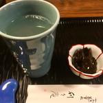 99333993 - 焼酎お湯割450円とお通し50円