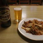 99416020 - 豚キムチと瓶ビール