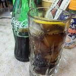 99508070 - コーラはお店で頼むと瓶で出て来て300円ですが、冷蔵ケースから買うとなぜかペットボトルで110円です。