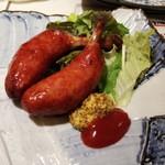 梅田 肉寿司 かじゅある和食 足立屋 - 骨付きウインナー